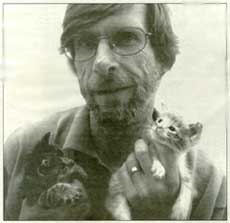 Mike Milne with Kittens, photo by Claire Martin